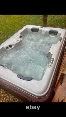 Storm Spa hot tub jacuzzi with silver interior & wood exterior